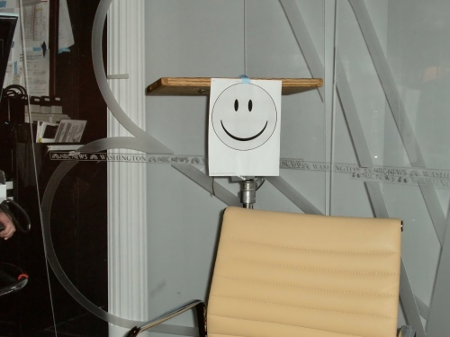 Mr smiley face is who you address.  NY people don't look like this!