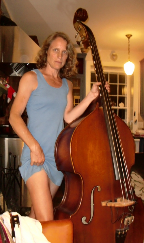 Bass player shows some thigh.